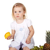 Child with fruits Royalty Free Stock Photography