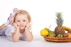 Child with fruits Royalty Free Stock Photo