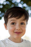 Child with fun expression. Child close up portrait doing faces outdoor Stock Photo