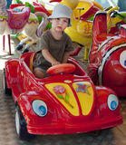 Child at funfair. A small boy on a funfair toy car ride royalty free stock photo