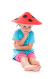 Child in a funny hat on his head Stock Images