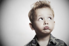 Child. funny little boy. close-up. joy. 4 eyers old. military shirt Stock Image