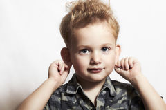 Child. funny little boy. close-up. joy. 4 eyers old. military shirt Stock Photo