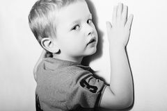 Child. Funny Little Boy.Monochrome Portrait of Fashionable Kid near the Wall Royalty Free Stock Photos