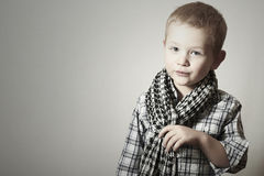 Child. funny little boy in scurf. Fashion Children. 4 years old. plaid shirt Stock Photography