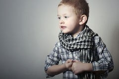 Child. funny little boy in scurf. Fashion Children. 4 years old. plaid shirt Royalty Free Stock Photography