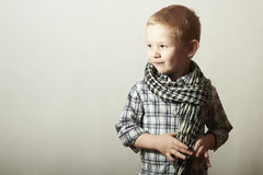 Child. funny little boy in scurf. Fashion Children. 4 years old. plaid shirt Stock Image
