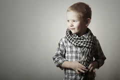 Child. funny little boy in scurf. Fashion Children. 4 years old. plaid shirt Stock Images