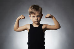 Child. Funny Little Boy.Sport Handsome Boy showing his hand biceps muscles Royalty Free Stock Photo