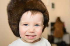Child in Fur Cap Stock Image