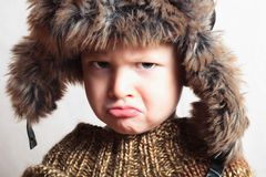 Child in fur hat.fashion.winter style.little boy.children Royalty Free Stock Image