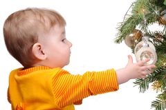 The child and a fur-tree toy Stock Photography