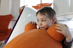 Child in furniture store Stock Images