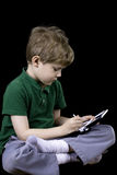 Child with a game. A child plays with a handheld electronic game stock images