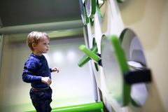 Child in game room. Portrait of a child playing in game room Royalty Free Stock Photo