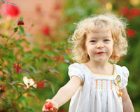 Child in garden. Beautiful child in summer garden stock image