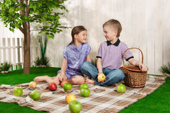 Child in the garden with apples Stock Photo