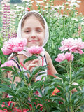 Child in the garden with flowers Stock Image