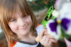 Child garden flowers planting plant gardening Royalty Free Stock Images