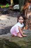 Child and garden rock Royalty Free Stock Photo