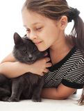 Child gently hugs  cat Stock Photos
