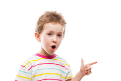 Child gesturing or finger pointing. Little amazed or surprised boy hand gesturing or index finger pointing Royalty Free Stock Image