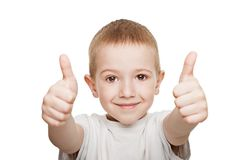 Child gesturing thumb up. Little boy hands gesturing thumb up success sign Stock Images
