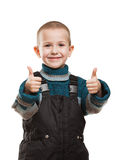 Child gesturing thumb up. Little smiling boy hands gesturing thumb up success sign Royalty Free Stock Photos