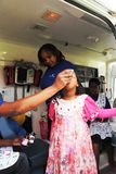 Child gets vaccine medical health Africa. A child is given vaccine in a mobile clinic in Nairobi Kenya Africa Royalty Free Stock Photography