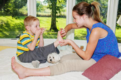 Child getting foot tickled Royalty Free Stock Image