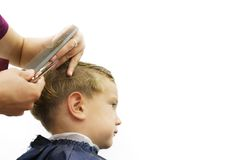 Child getting haircut Stock Photography
