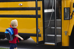 Free Child Getting On A School Bus Royalty Free Stock Photo - 26818415