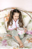 The child with a gift Stock Image