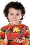 Child with a gift box Stock Images