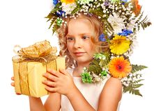 Child with gift box and flower. Royalty Free Stock Image
