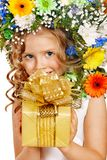 Child with gift box and flower. Royalty Free Stock Photography