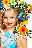 Child with gift box and flower. Stock Photos