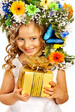 Child with gift box and flower. Royalty Free Stock Photos
