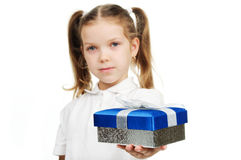Child with a gift box Royalty Free Stock Images