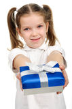 Child with a gift box Stock Photos