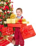 Child with gift box near Christmas tree. Stock Photography