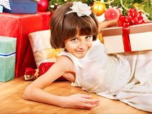 Child with gift box near Christmas tree. Happy child with gift box near Christmas tree royalty free stock images