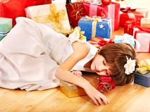 Child with gift box near Christmas tree. Stock Photos