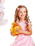 Child with gift box near white Christmas tree. Stock Photography