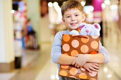 Child with gift Stock Images