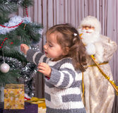 A child with a gifts the Christmas tree. Royalty Free Stock Photography