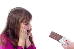 Child Girl Against Chocolate Royalty Free Stock Photography