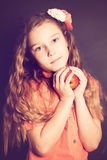 Child girl with apple fruit Royalty Free Stock Photo