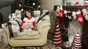 Child Girl on Armchair with Christmas Gift Stock Photography