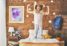 Girl in an astronaut costume Stock Photo